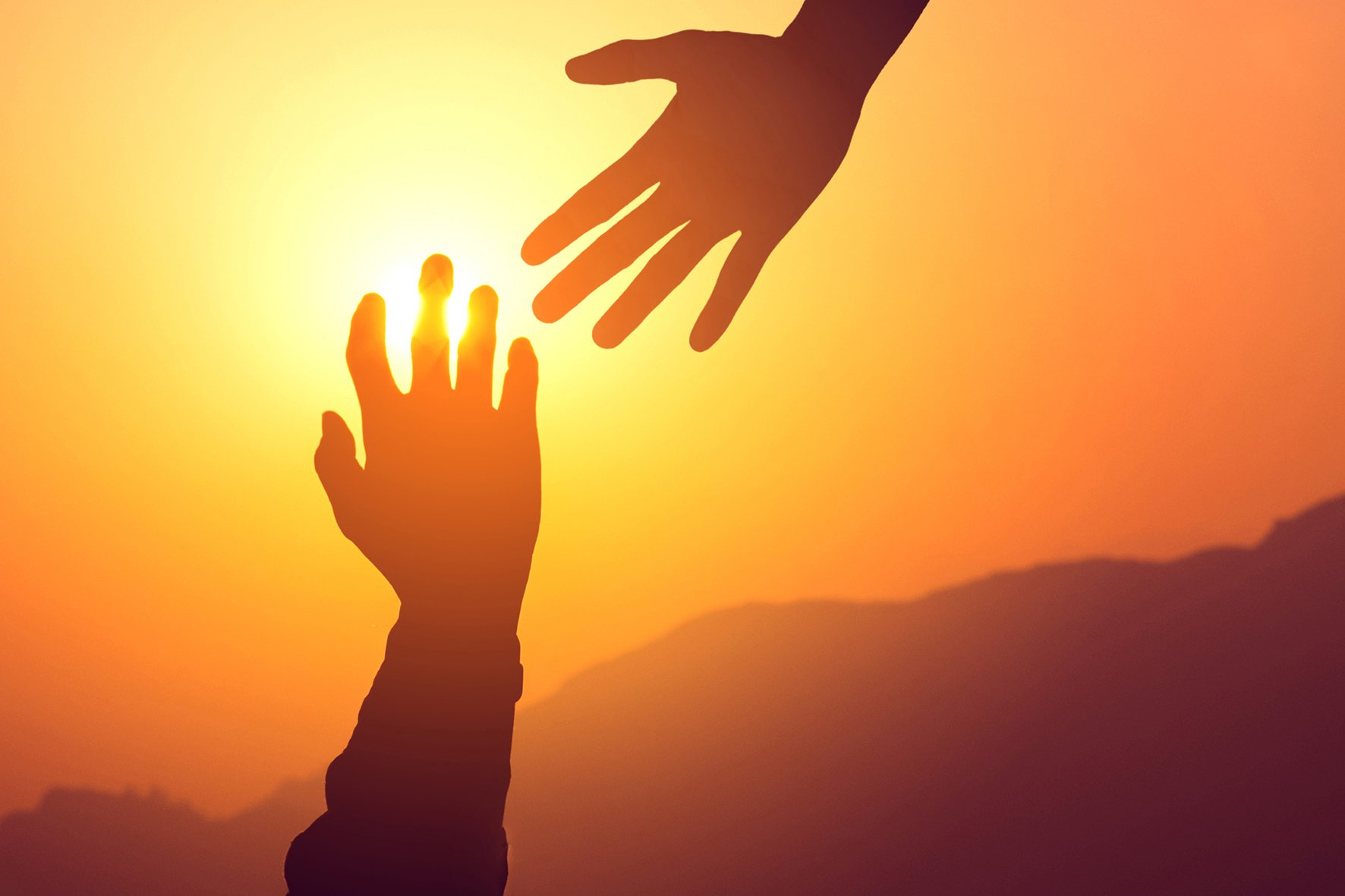 Reaching hands_shutterstock_sml